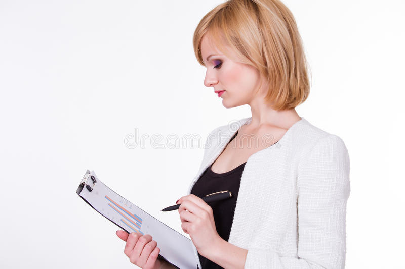 Business, finances and economics - pretty young. Businesswoman holding paper with graph. Female on white background royalty free stock photography