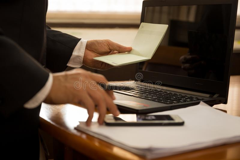 Business financial hand hold book statement and work with laptop. royalty free stock photo