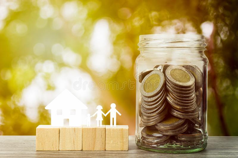 Business and financial property concept for home loan, mortgage, saving and investment. A small house model with stack of coins in royalty free stock photo