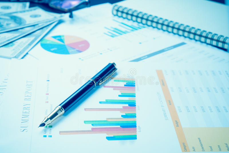 Download Business And Financial Report With Pen And Calculator On Wooden Stock Image - Image: 53504273