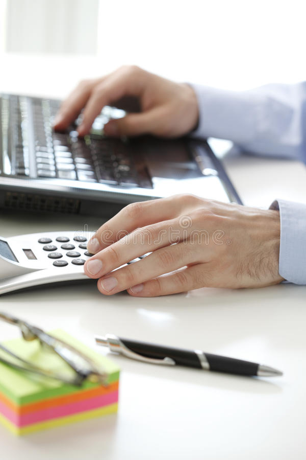 Business financier working at bank. Financial adviser calculating data while working at bank royalty free stock image