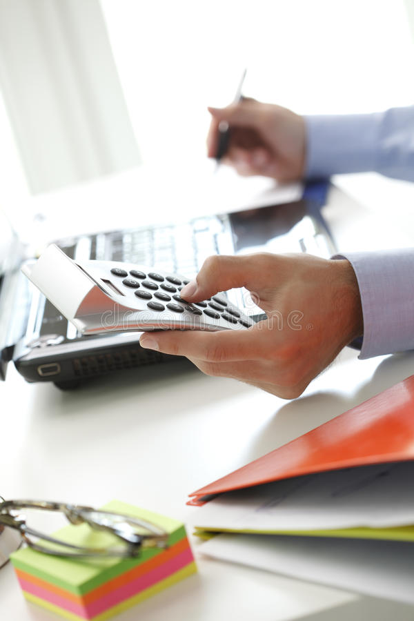 Business financier working at bank. Financial adviser calculating datas while working at bank royalty free stock photos