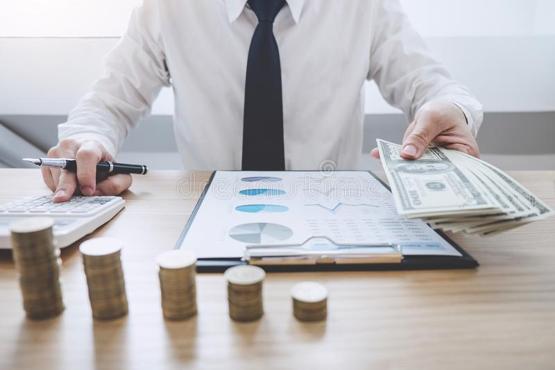 Business Financing Accounting Banking Concept, businessman doing finances and calculate about cost to real estate investment, royalty free stock photo