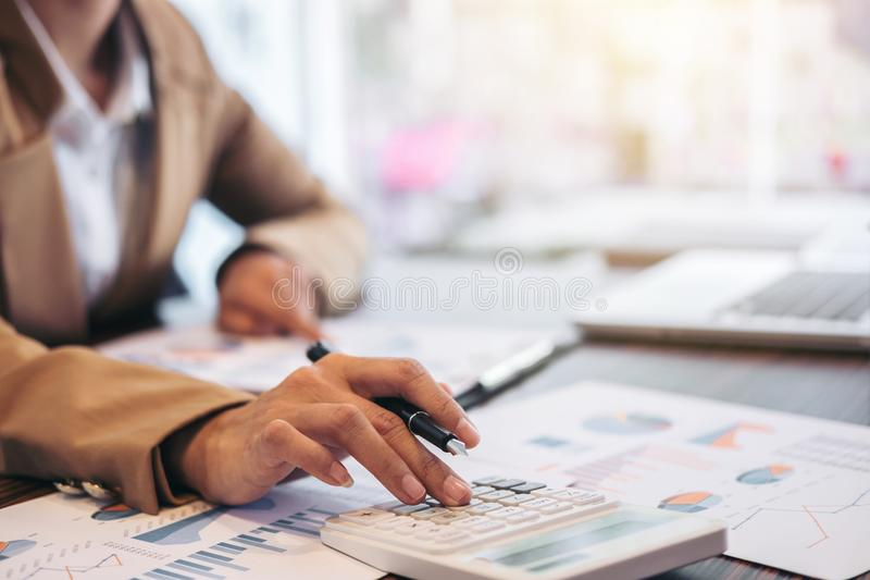 Business Financing Accounting Banking Concept, businesswoman doing finances and calculate about cost to real estate investment. And in other, tax system stock photo