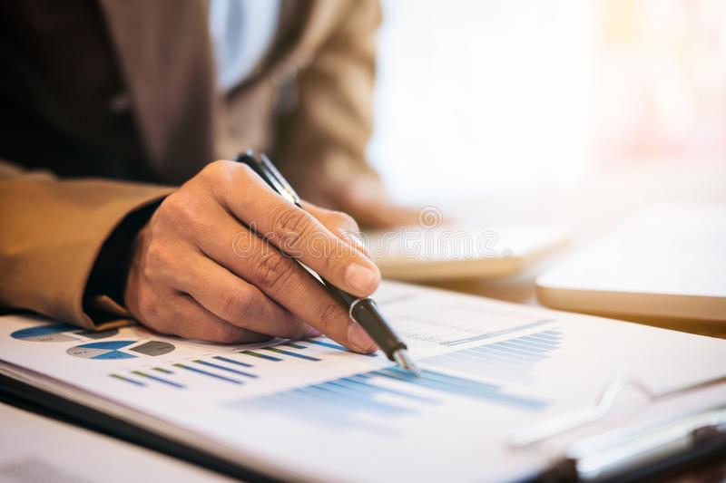 Business Financing Accounting Banking Concept, businesswoman doing finances and calculate about cost to real estate investment. And in other, tax system stock image