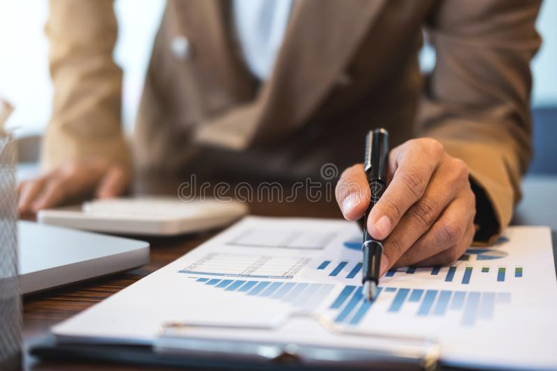 Business Financing Accounting Banking Concept, businesswoman doing finances and calculate about cost to real estate investment stock photography