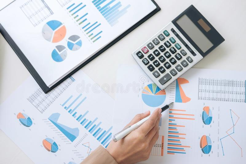 Business Financing Accounting Banking Concept, businesswoman working new plan financial graph data on laptop and doing. Finances, calculate investment and royalty free stock photo