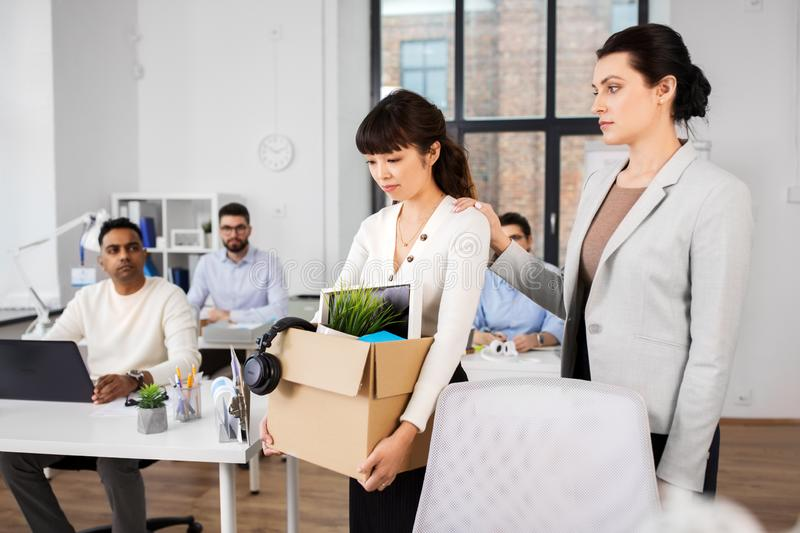 Colleague soothing sad fired female office worker royalty free stock images