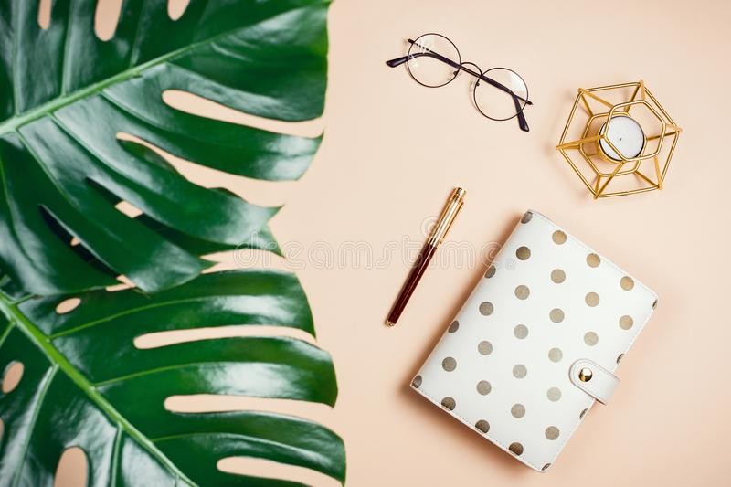 Business flatlay mockup with philodendron monstera leaves, planner, candle and glasses stock photography