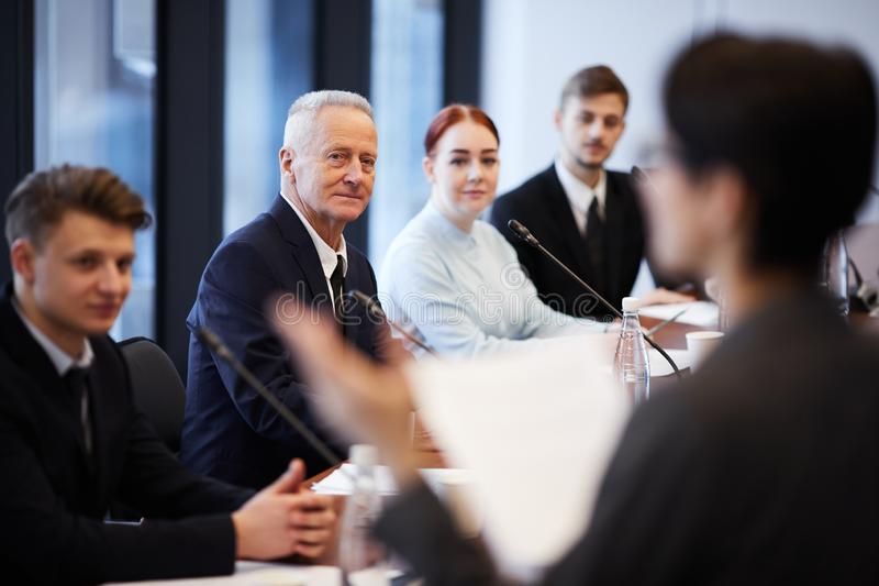 Business Forum. Group of business people sitting in row and listening to presentation in conference room, copy space stock images