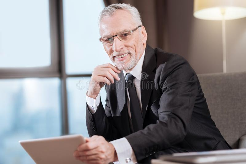 Senior glad man preparing for conference royalty free stock photography