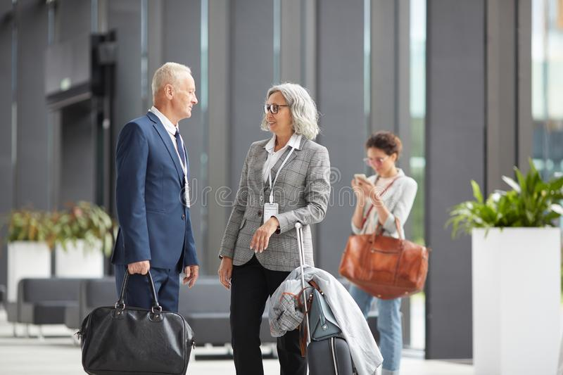 Business forum participants meeting in airport stock image