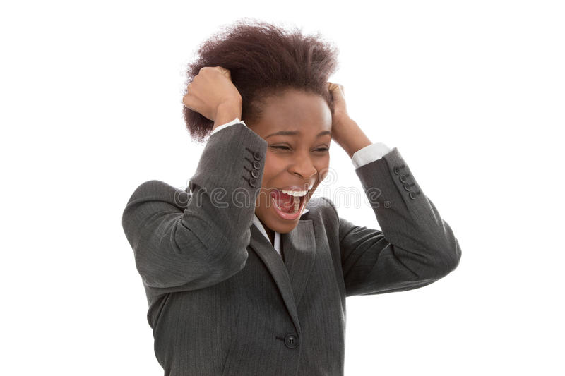 Business: frustrated black woman pulling out hair screaming isolated on white background royalty free stock photography