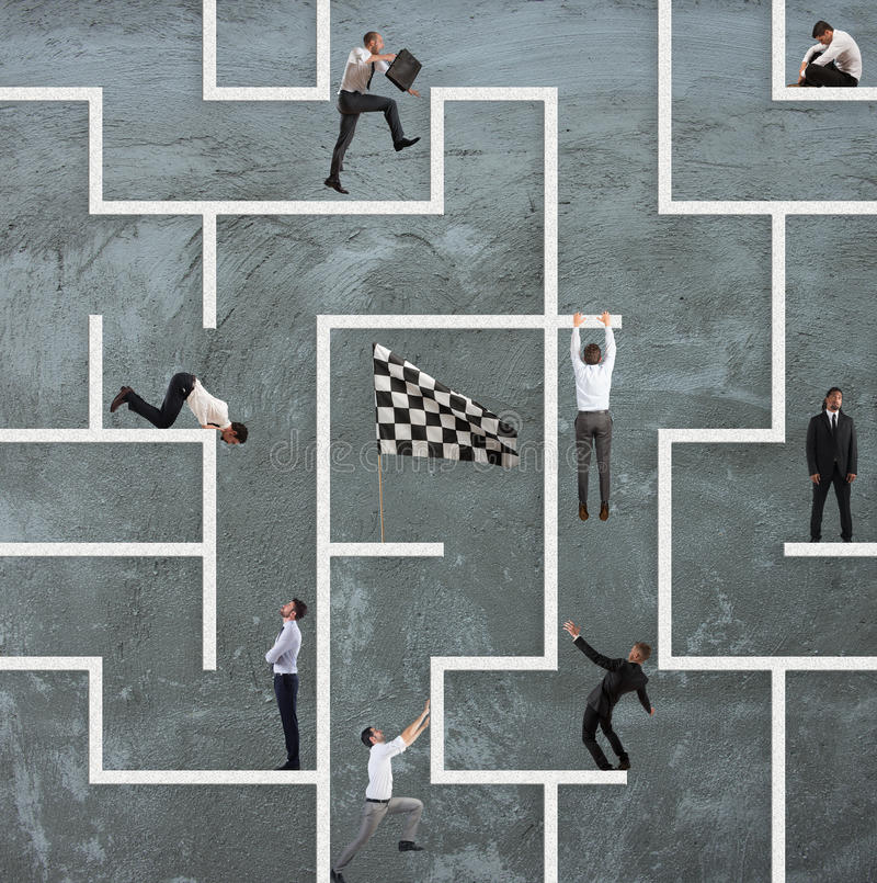Business game of maze. Business person inside a big maze like a business game stock photo