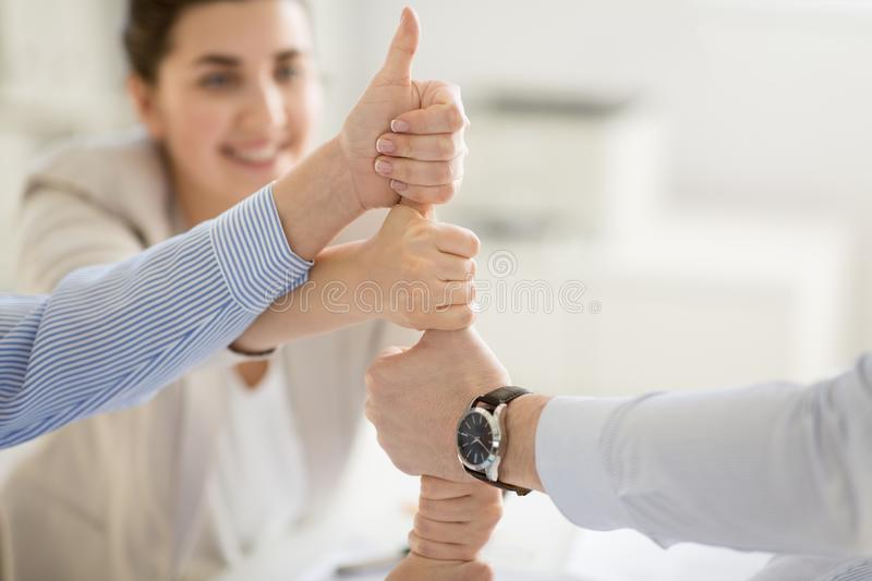 Group of business team making thumbs up gesture stock photos
