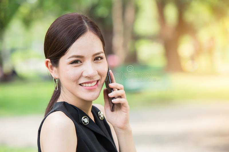 Business girl calling outdoor looking camera royalty free stock photos