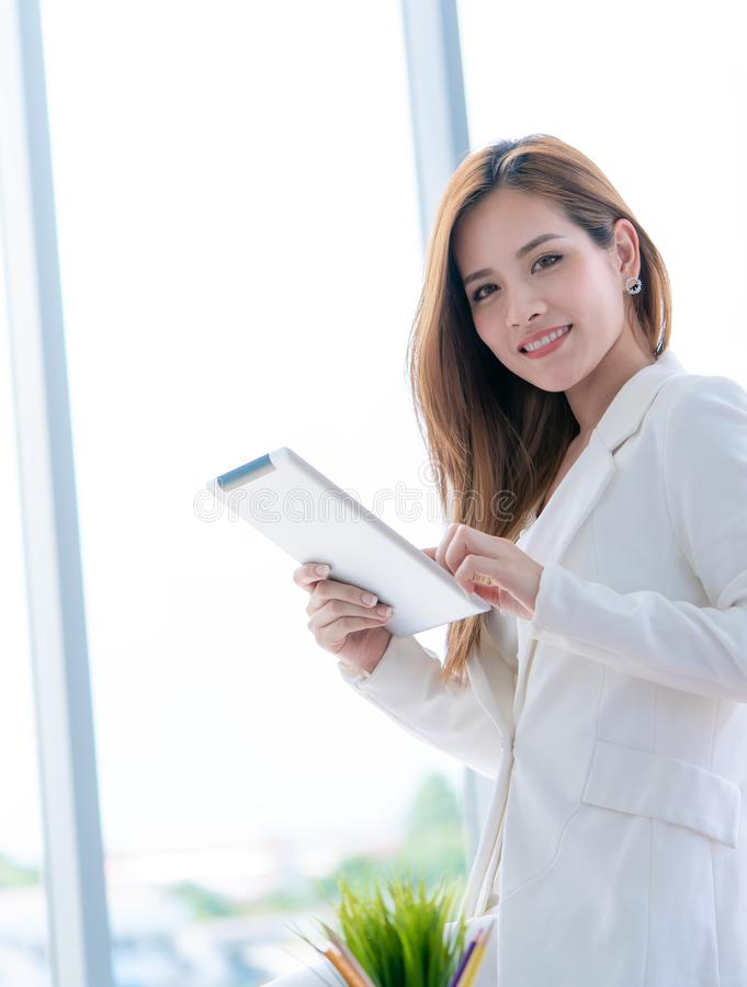 Business girl is checking report on tablet stock photos
