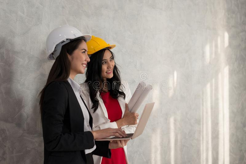 Business girl and engineer with Asian people work with laptop ar royalty free stock images