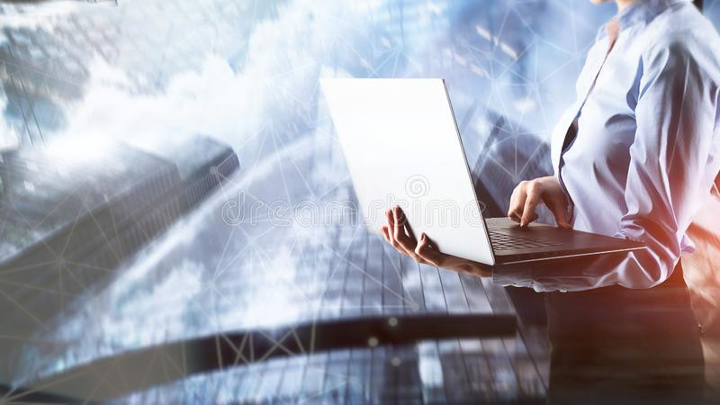 Business girl with laptop on city background. Businessman in a jacket points his finger at the camera stock photo