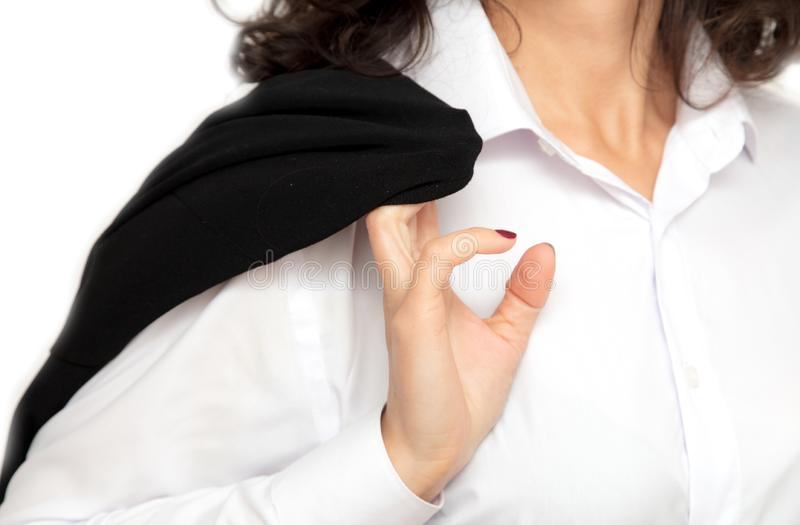 Business girl puts black jacket on a white shirt royalty free stock image