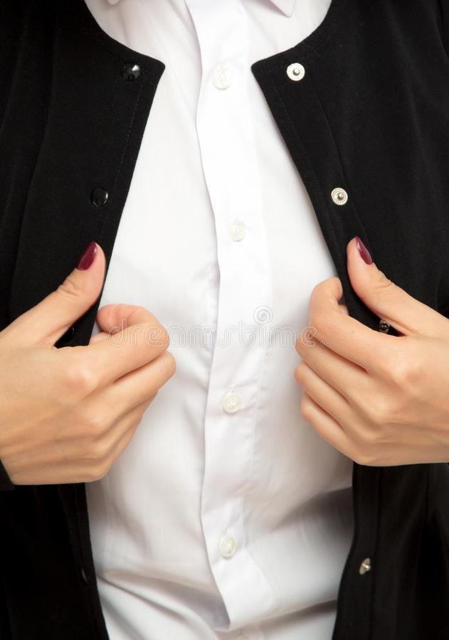 Business girl puts black jacket on a white shirt royalty free stock images