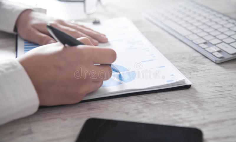 Business girl working in financial graphs. Working in office royalty free stock images
