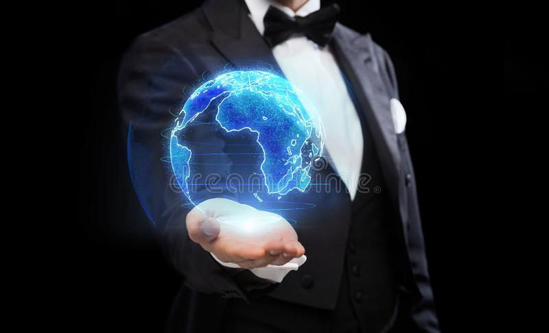 Close up of magician with earth hologram royalty free stock photography