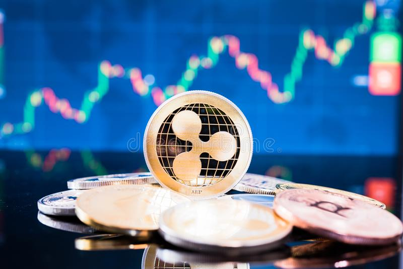 Business gold xrp coin currency finance money. On graph chart background royalty free stock photography