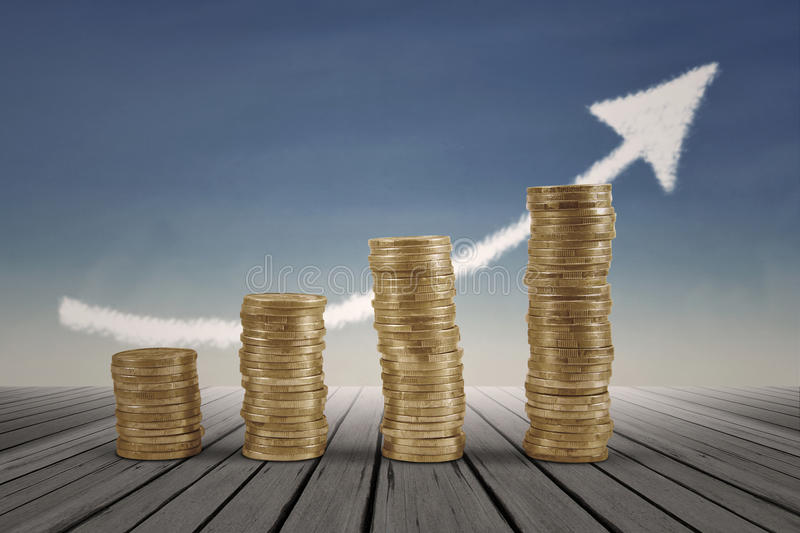 Business graph with arrow and coins. Showing profits and gains stock photos