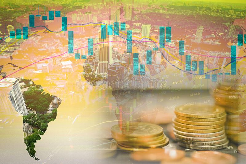 Business graph chart of stock market investment trading on world map double exposure of coins for finance and city building top. View background stock images