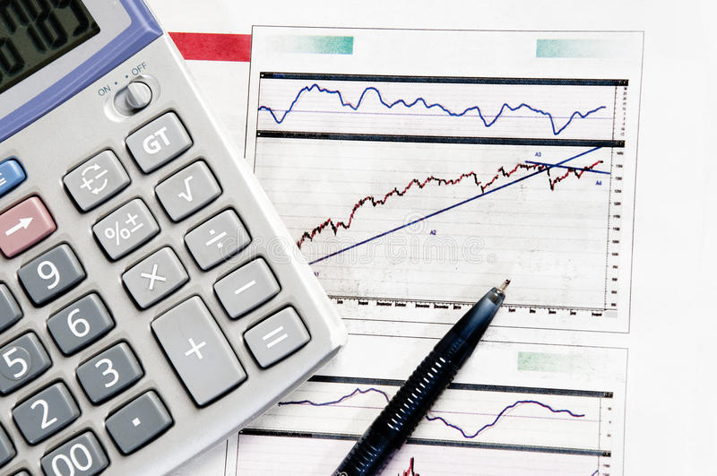 Business graphics computing. Calculator and pen in the business graphics royalty free stock images