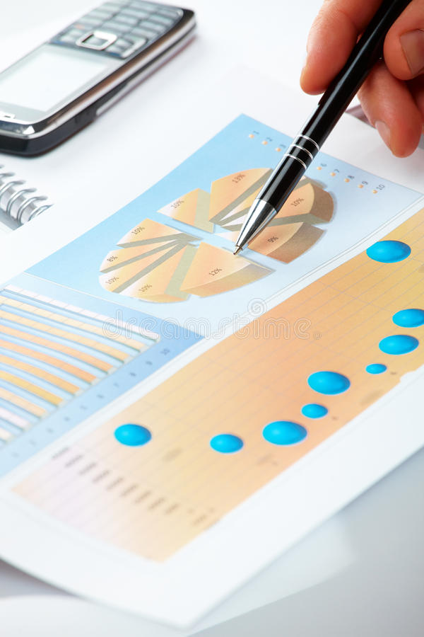 Business graphs and male hand stock photos