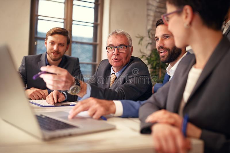 Business group of creative people having a meeting with laptop stock photography
