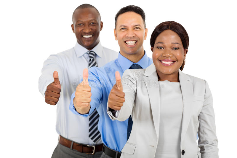 Business group thumbs up. Professional business group giving thumbs up on white background stock photo