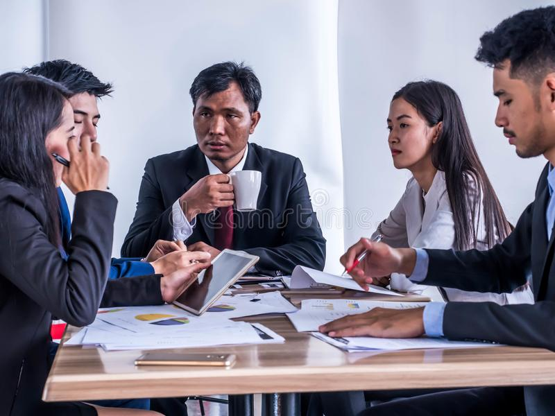 Business groups offer management plans to investors through tablets royalty free stock photo