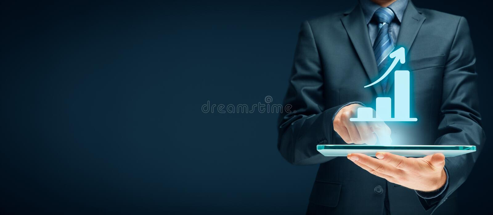 Business growth analysis. Concept. Businessman plan growth and increase of positive indicators in his business stock photo