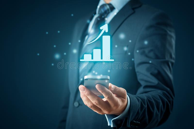 Business growth analysis on smart phone stock photography