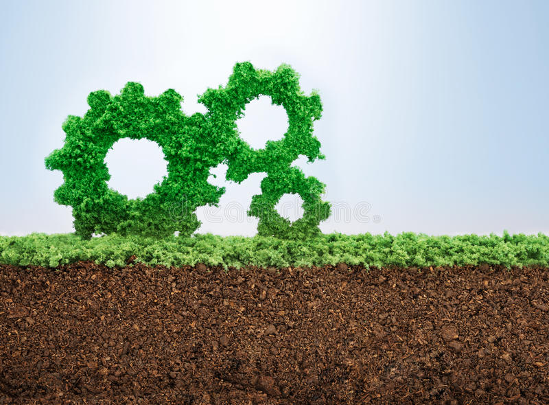 Business growth. Concept with grass growing in shape of gears royalty free stock photos