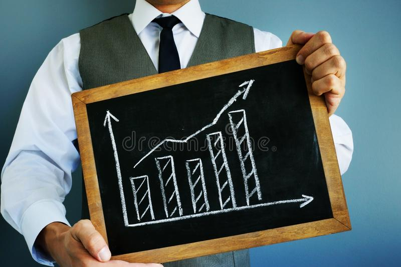 Business growth concept. Graph with raised arrow stock images