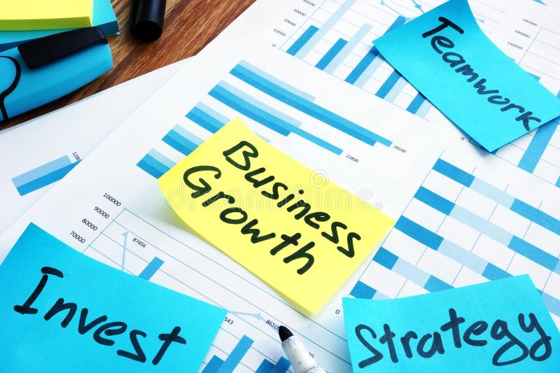 Business growth concept. Report and marks invest, teamwork and strategy stock images