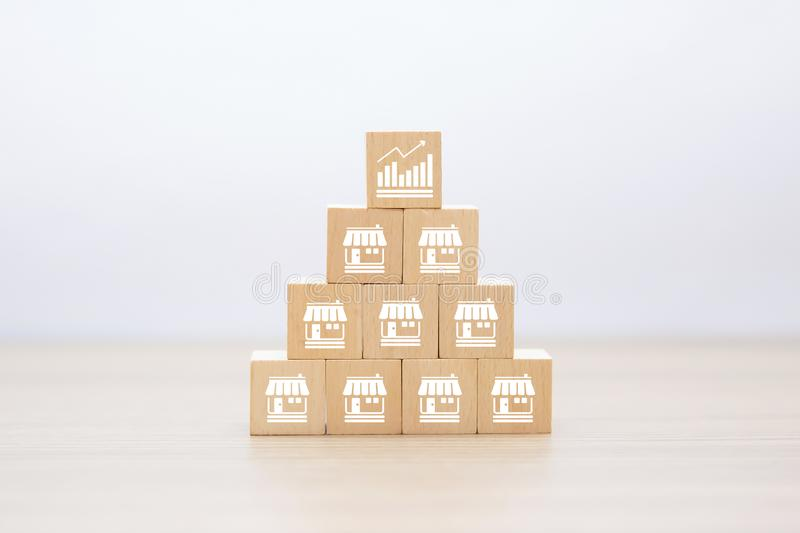 Business growth and Franchise icons Store on wooden block. Business growth and Franchise icons Store on wooden blocks concept stock photography