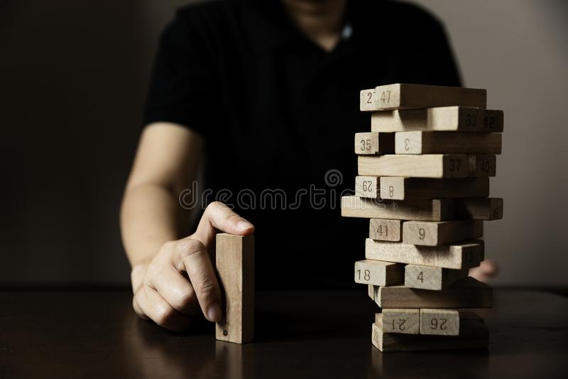 Business hand build wood block from others royalty free stock photo