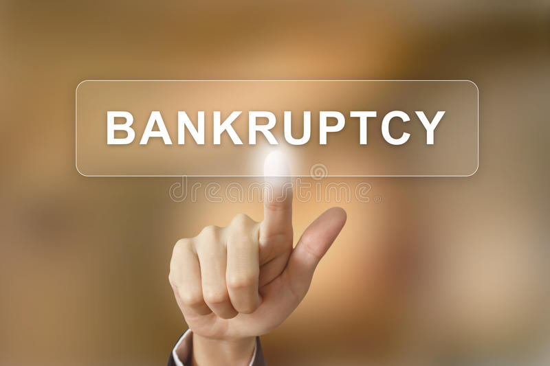Business hand clicking bankruptcy button on blurred background. Business hand pushing bankruptcy button on blurred background stock photography