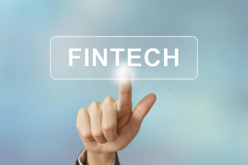 Business hand clicking fintech or Financial technology button on stock images