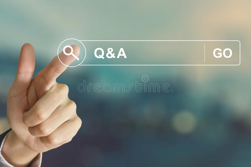 Business hand clicking Q&A or Question and Answer button on sear stock photography
