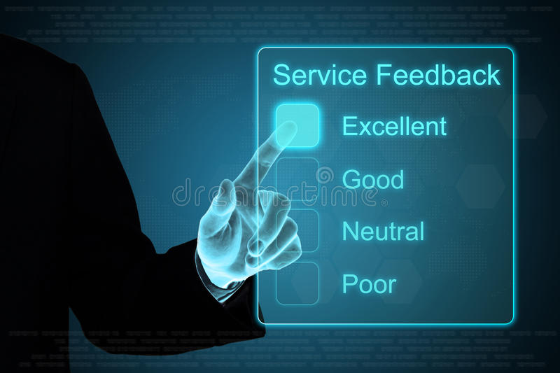 Business hand clicking service feedback on touch screen. Business hand pushing service feedback on a touch screen interface stock photography