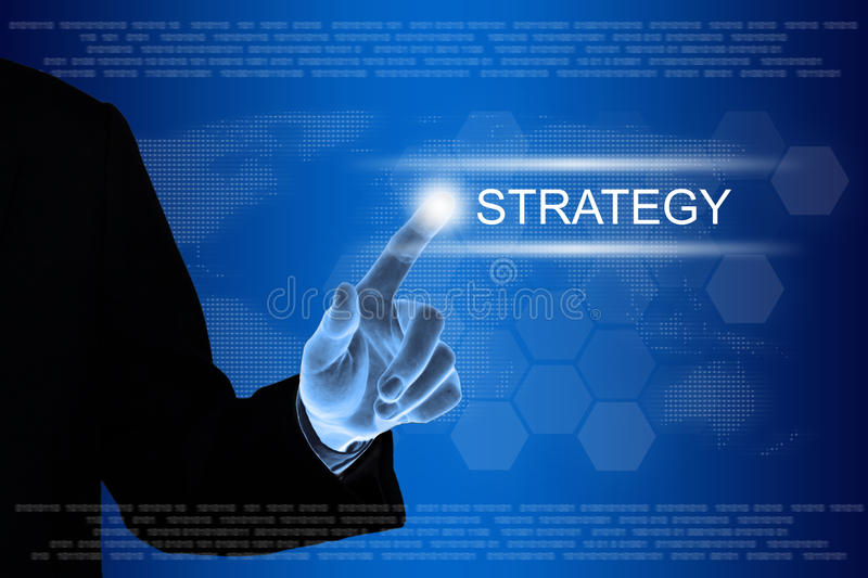 Business hand clicking strategy button on touch screen. Business hand pushing strategy button on a touch screen interface royalty free stock photos