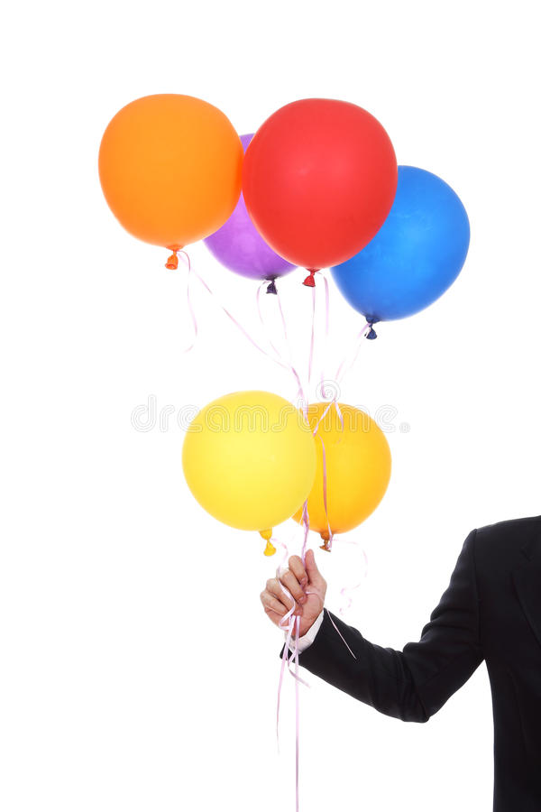 Business hand with colorful balloons. Isolated on a white background royalty free stock images