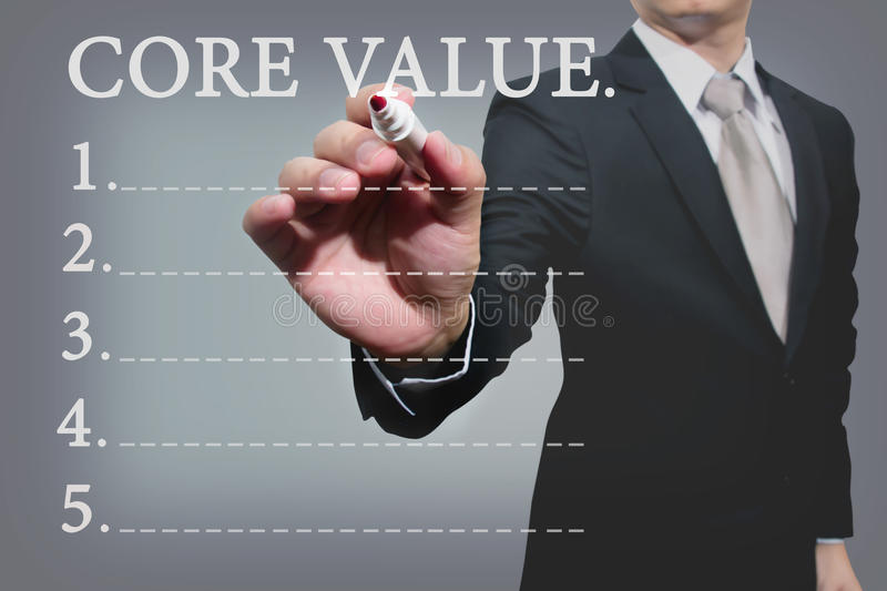Business hand with pen mark core value. Young business hand with pen mark core value royalty free stock photos