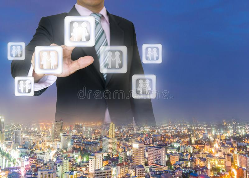 Business hand pushing a button shake hands on a touch screen stock images